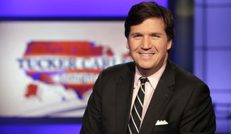 "Tucker Carlson, host of ""Tucker Carlson Tonight,"" poses for photos in a Fox News Channel studio, in New York. (AP Photo/Richard Drew)"
