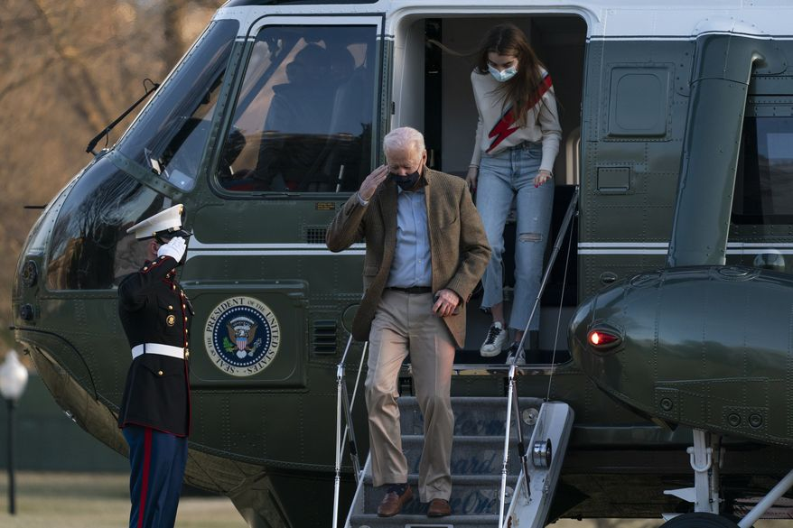 President Joe Biden, followed by his granddaughter Natalie Biden, disembark Marine One on the South Lawn upon arrival at the White House in Washington from a weekend trip to Wilmington, Del., Sunday, March 14, 2021. (AP Photo/Manuel Balce Ceneta)