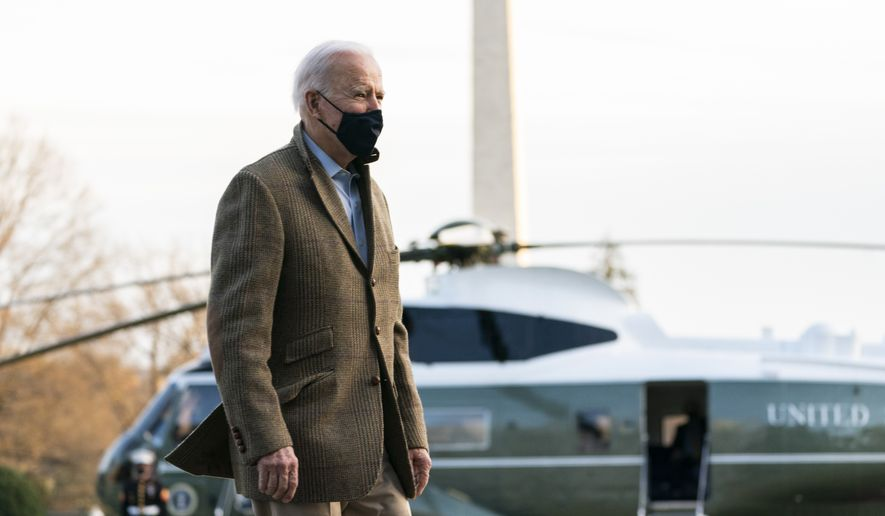 President Joe Biden walks on the South Lawn towards the gathered media members upon arrival at the White House in Washington from a weekend trip to Wilmington, Del., Sunday, March 14, 2021. (AP Photo/Manuel Balce Ceneta)
