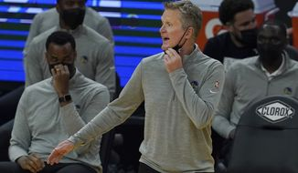 Golden State Warriors head coach Steve Kerr reacts during the first half of his team's NBA basketball game against the Utah Jazz in San Francisco, Sunday, March 14, 2021. (AP Photo/Jeff Chiu)