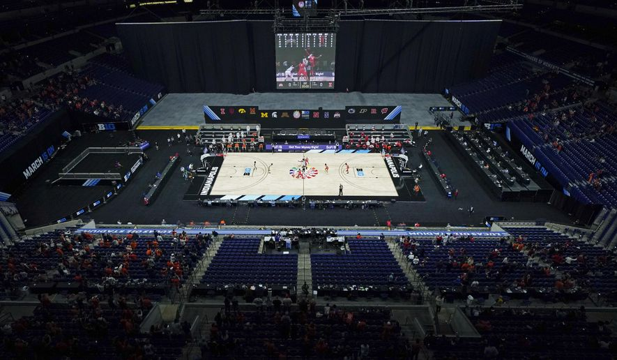 Illinois and Ohio State tipoff for an NCAA college basketball championship game at the Big Ten Conference tournament, Sunday, March 14, 2021, in Indianapolis. (AP Photo/Darron Cummings)