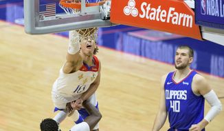 New Orleans Pelicans center Jaxson Hayes (10) dunks against Los Angeles Clippers guard Reggie Jackson (1) in the second half of an NBA basketball game in New Orleans, Sunday, March 14, 2021. (AP Photo/Matthew Hinton)