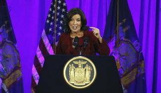 In this Jan. 1, 2019, file photo, New York Lt. Gov. Kathy Hochul delivers her remarks after taking the oath of office, on Ellis Island in New York Harbor. As a chorus of top Democrats demanded Gov. Andrew Cuomo's resignation over sexual harassment allegations last week, Hochul, who would succeed him if he stepped down, did what she's done for most of her time in office: kept a discreet profile. (AP Photo/Richard Drew, File)