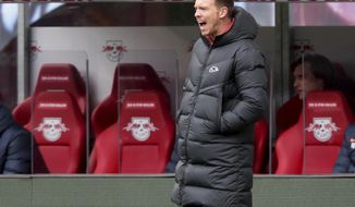 Leipzig's head coach Julian Nagelsmann shouts during the German Bundesliga soccer match between RB Leipzig and Eintracht Frankfurt in Leipzig, Germany, Sunday, March 14, 2021. (AP Photo/Michael Sohn)