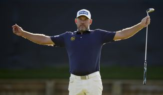 Lee Westwood, of England, celebrates after a birdie on the 18th hole during the final round of The Players Championship golf tournament Sunday, March 14, 2021, in Ponte Vedra Beach, Fla. (AP Photo/Gerald Herbert)