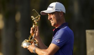 Justin Thomas holds the trophy after winning The Players Championship golf tournament Sunday, March 14, 2021, in Ponte Vedra Beach, Fla. (AP Photo/Gerald Herbert)
