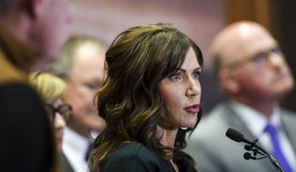 In this March 17, 2020, file photo, South Dakota Gov. Kristi Noem gives an update on the coronavirus in South Dakota, at the Sanford Center in Sioux Falls, S.D. Some of the nation's governors' offices routinely block access to public records to keep the public in the dark about key decisions involving the coronavirus pandemic. Noem's outspoken business-as-usual approach throughout the coronavirus pandemic has made her a darling of national conservatives and allowed her to hopscotch across the country as a fundraising force. (Abigail Dollins/The Argus Leader via AP, File)/The Argus Leader via AP)