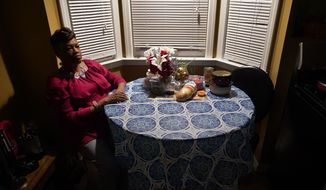Karla Jefferies sits in her kitchen in Detroit, Friday, March 5, 2021. Jefferies, 64, a retired state worker in Detroit, Michigan, tested positive for COVID-19 in March 2020 and has been bothered by puzzling symptoms ever since. First it was fatigue, fever, and no taste or smell. Then came brain fog, insomnia, a nagging smell of something burning that only recently disappeared, and intermittent ringing in her ears. Now she can't hear out of her left ear. (AP Photo/Paul Sancya) **FILE**