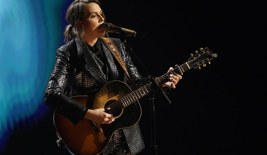 """Brandi Carlile performs during the """"In Memoriam"""" section of the 63rd Grammy Awards at the Los Angeles Convention Center, Tuesday, March 9, 2021. The awards show airs on March 14 with both live and prerecorded segments. (AP Photo/Chris Pizzello)"""