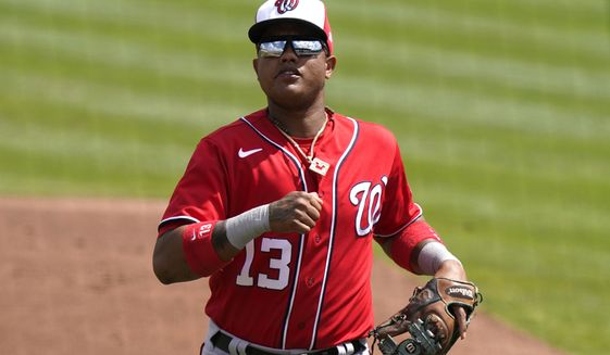 Washington Nationals' Starlin Castro (13) goes to the dugout during a spring training baseball game against the St. Louis Cardinals, Monday, March 15, 2021, in Jupiter, Fla. (AP Photo/Lynne Sladky)