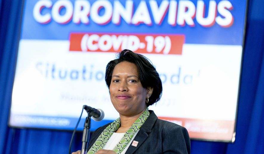 Washington Mayor Muriel Bowser arrives to give a coronavirus update at a news conference, Monday, March 15, 2021, in Washington. (AP Photo/Andrew Harnik) **FILE**