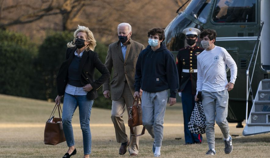 President Joe Biden and first lady Jill Biden with their grandson Hunter Biden, walk on the South Lawn upon arrival at the White House in Washington from a weekend trip to Wilmington, Del., Sunday, March 14, 2021. (AP Photo/Manuel Balce Ceneta)