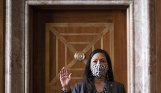 FILE - In this Feb. 23, 2021, file photo, Rep. Deb Haaland, D-N.M., is sworn in before the Senate Committee on Energy and Natural Resources hearing on her nomination to be Interior Secretary on Capitol Hill in Washington. (Jim Watson/Pool via AP, File}