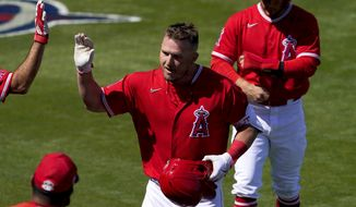 Los Angeles Angels' Mike Trout celebrate his two run home run during the first inning of a spring training baseball game against the San Francisco Giants, Thursday, March 11, 2021, in Tempe, Ariz. (AP Photo/Matt York)