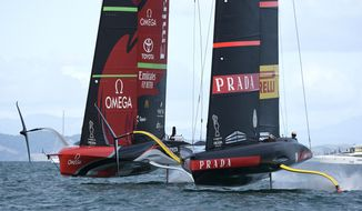 Italy's Luna Rossa, right, races Emirates Team New Zealand in race eight of the America's Cup on Auckland's Waitemata Harbour, Monday, March 15, 2021. (Chris Cameron/Photosport via AP)