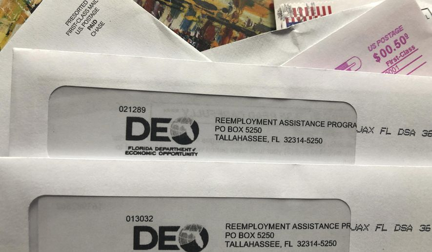 In this Thursday, Nov. 5, 2020, file photo, envelopes from the Florida Department of Economic Opportunity Reemployment Assistance Program are shown, in Surfside, Fla. On Friday, July 23, 2021, the DEO announced that hackers may have stolen personal information for possibly tens of thousands of state residents seeking or receiving unemployment benefits. (AP Photo/Wilfredo Lee, File)