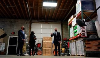 President Biden toured Smith Flooring Inc. in Chester, Pennsylvania, on Tuesday and met with owners Kristen and James Smith. Smith Flooring was one of the businesses that received a Paycheck Protection Program loan last year. Mr. Biden said the PPP program needs more oversight. (Associated Press)