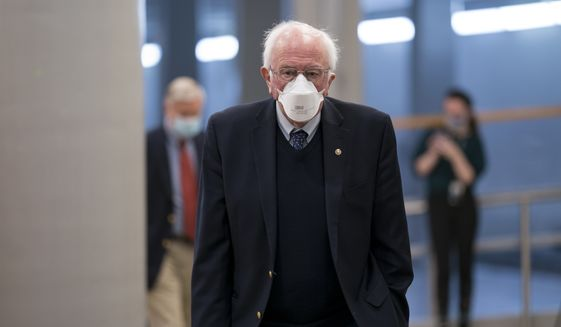Sen. Bernie Sanders, I-Vt., chairman of the Senate Budget Committee, arrives as the Senate holds votes on nominees for the Biden administration, at the Capitol in Washington, Tuesday, March 16, 2021. (AP Photo/J. Scott Applewhite)