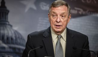 Senate Majority Whip Dick Durbin, D-Ill., speaks during a news conference at the Capitol in Washington, Tuesday, March 16, 2021. (Samuel Corum/Pool via AP)