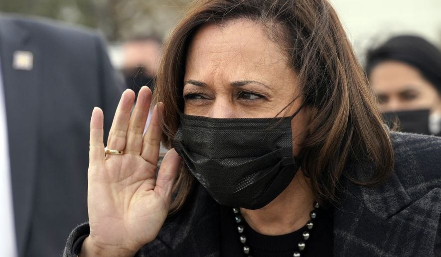 Vice President Kamala Harris listens to a question from the press before she boards Air Force Two in Denver, Tuesday March 16, 2021, to return to Washington. (AP Photo/Jacquelyn Martin)