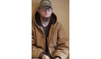 This undated photo provided by the Cherokee County Sheriff's Office, in Georgia, shows Robert Aaron Long, of Woodstock, Ga. After a manhunt late Tuesday, March 16, 2021, authorities took Long into custody in connection with several fatal shootings at massage parlors in the Atlanta area. (Courtesy of Cherokee County Sheriff's Office via AP)