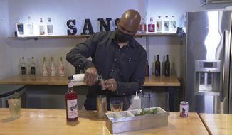 In this March 5, 2021, photo, owner Chris Marshall prepares an alcohol-free cocktail at San Bars in Austin, Texas. According to IWSR Drinks Market Analysis, global consumption of zero-proof beer, wine and spirits is growing two to three times faster than overall alcohol consumption. (AP Photo/John Mone)