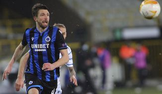 Brugge's Brandon Mechele chases the ball during the Europa League round of 32 second leg soccer match between Club Brugge and Dynamo Kyiv at the Bosuil stadium in Bruges, Belgium, Thursday, Feb. 25, 2021. (AP Photo/Olivier Matthys)