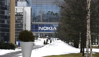 The headquarters of the Finnish telecoms company Nokia, in Espoo, Finland, Tuesday March 16, 2021. Nokia has announced plans to cut up to 10,000 jobs worldwide over the next two years, aiming to make savings of around 600 million euros by the end of 2023. (Heikki Saukkomaa/Lehtikuva via AP)