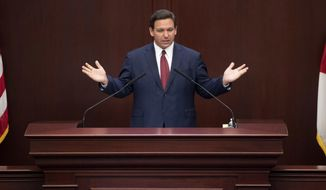 Florida Gov. Ron DeSantis gives his State of the State speech in the House of Representatives chamber on the first day of the 2021 Legislative Session in Tallahassee, Fla. Tuesday, March 2, 2021. (Tori Lynn Schneider/Tallahassee Democrat via AP)