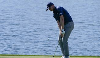 Daniel Berger chips to the green on the 18th hole during the second round of the The Players Championship golf tournament Friday, March 12, 2021, in Ponte Vedra Beach, Fla. (AP Photo/Gerald Herbert)