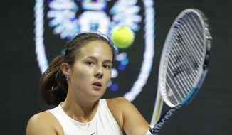 Daria Kasatkina of Russia returns the ball to Clara Tauson of Denmark during the St. Petersburg Ladies Trophy-2021 tennis tournament match in St.Petersburg, Russia, Tuesday, March 16, 2021. (AP Photo/Dmitri Lovetsky)