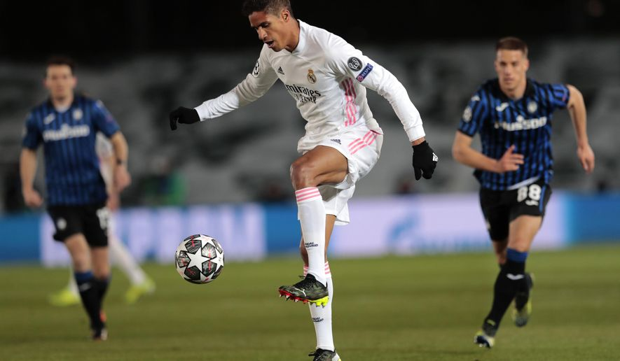 Real Madrid's Raphael Varane controls the ball during the Champions League, round of 16, second leg soccer match between Atalanta and Real Madrid at the Alfredo di Stefano stadium in Madrid, Spain, Tuesday, March 16, 2021. (AP Photo/Bernat Armangue)