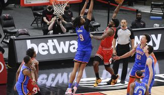 Oklahoma City Thunder center Moses Brown, back left, fouls Chicago Bulls forward Patrick Williams during the third quarter of an NBA basketball game in Chicago, Tuesday, March 16, 2021. (AP Photo/Mark Black)