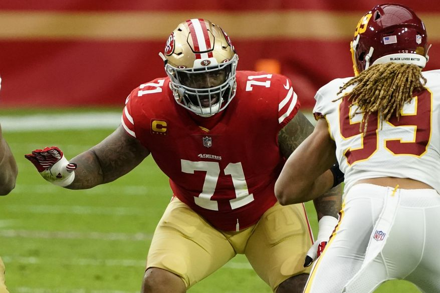 San Francisco 49ers offensive tackle Trent Williams (71) plays during an NFL football game against the Washington Football Team in Glendale, Ariz., in this Sunday, Dec. 13, 2020, file photo. The 49ers locked up their biggest potential free agent for the long term by agreeing to give star left tackle Trent Williams the richest contract ever for an offensive lineman. Williams' agents at Elite Loyalty Sports say the deal agreed to early Wednesday morning, March 17, 2021, will pay Williams $138.1 million over the next six years, surpassing the $138 million deal David Bakhtiari got from during last season. (AP Photo/Rick Scuteri, File). **FILE**