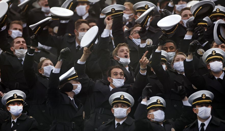 In this Dec. 12, 2020, photo, Navy midshipmen cheer during the first half of an NCAA college football game between Navy and Army, in West Point, N.Y. Minority students are significantly underrepresented when it comes to getting nominations from members of Congress to attend the nation's military service academies, according to an analysis released Wednesday, March 17, 2021. (AP Photo/Adam Hunger) **FILE**