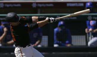 San Francisco Giants' Buster Posey breaks a bat while hitting for a double during the first inning of a spring training baseball game against the Chicago Cubs Wednesday, March 10, 2021, in Scottsdale, Ariz. (AP Photo/Ashley Landis)