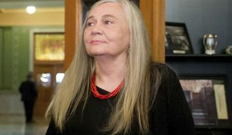 """FILE - In this Sept. 14, 2015, file photo, Pulitzer Prize-winning writer Marilynne Robinson visits the State Library of Iowa in the Ola Babcock Miller Building in Des Moines, Iowa.  Oprah Winfrey announced Tuesday that she has selected Robinson's acclaimed quartet of """"Gilead"""" narratives for her next book club selection. Robinson won the Pulitzer Prize in 2005 for """"Gilead,"""" the first of her books set in the fictional Iowa town of Gilead. (AP Photo/Andrew Harnik, File)"""