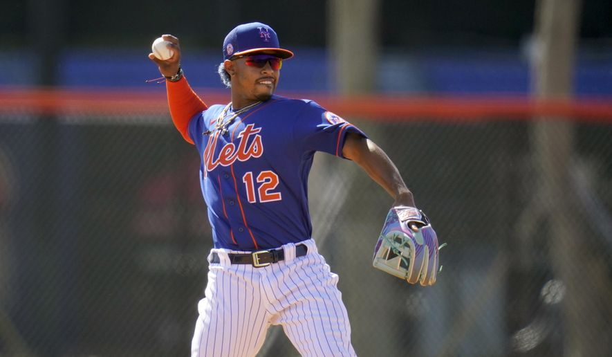 New York Mets infielder Francisco Lindor throws during spring training baseball practice Tuesday, Feb. 23, 2021, in Port St. Lucie, Fla. (AP Photo/Jeff Roberson)