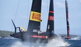 Emirates Team New Zealand, right, leads Italy's Luna Rossa in race ten of the America's Cup on Auckland's Waitemata Harbour, Wednesday, March 17, 2021. (Chris Cameron/Photosport via AP)