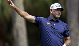 Lee Westwood, of England, watches his tee shot on the second hole during the final round of The Players Championship golf tournament Sunday, March 14, 2021, in Ponte Vedra Beach, Fla. (AP Photo/Gerald Herbert)