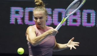 Svetlana Kuznetsova of Russia returns the ball to Wang Xinyu of China during the St. Petersburg Ladies Trophy-2021 tennis tournament match in St.Petersburg, Russia, Wednesday, March 17, 2021. (AP Photo/Dmitri Lovetsky)
