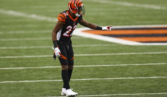 FILE - Cincinnati Bengals cornerback William Jackson (22) plays against the Dallas Cowboys in the second half of an NFL football game in Cincinnati, in this Sunday, Dec. 13, 2020, file photo. Washington has agreed to sign cornerback William Jackson. Jackson's contract with Washington is worth $42 million over three years with $26 million guaranteed, a person with knowledge of the signing tells The Associated Press. The person spoke to The Associated Press on condition of anonymity Wednesday, March 17, 2021, because the team does not release contract terms. (AP Photo/Aaron Doster, File)