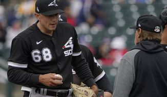 Chicago White Sox pitcher Tyler Johnson (68) is taken out of the baseball game by manager Tony La Russa, right, during the eighth inning of a spring training matchup against the Texas Rangers, Friday, March 12, 2021, in Surprise, Ariz. (AP Photo/Sue Ogrocki)