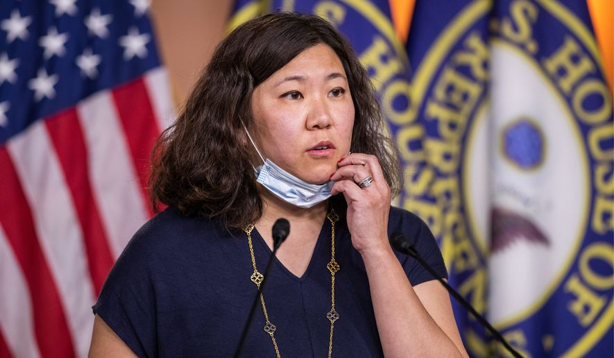 """""""Your president and your party and your colleagues can talk about issues with any other country that you want, but you don't have to do it by putting a bull's-eye on the back of Asian Americans across this country,"""" said Rep. Grace Meng, New York Democrat. (Associated Press photographs)"""