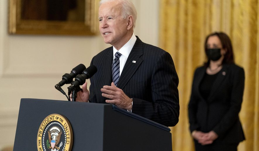 President Joe Biden, accompanied by Vice President Kamala Harris, right, speaks about COVID-19 vaccinations in the East Room of the White House, Thursday, March 18, 2021, in Washington. (AP Photo/Andrew Harnik)