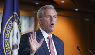 House Minority Leader Kevin McCarthy, R-Calif., criticizes Democrats on immigration policy during his weekly news conference at the Capitol in Washington, Thursday, March 18, 2021. He also said that Rep. Eric Swalwell, D-Calif., should be removed from the House Intelligence Committee. (AP Photo/J. Scott Applewhite)