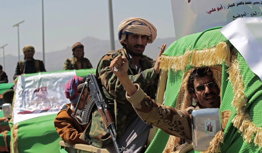 In this Feb. 16, 2021 file photo, Houthi rebel fighters attend a funeral procession for Houthis who were killed in recent fighting with forces of Yemen's Saudi-backed internationally recognized government during their funeral procession, in Sanaa, Yemen. An offensive by Yemen's Iran-backed Houthi rebels in the province of Marib has already displaced hundreds of thousands, but it is also sparking fighting on the country's other front lines and endangering peace efforts to end the grinding civil war. (AP Photo/Hani Mohammed, File)