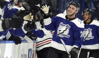 Tampa Bay Lightning left wing Ross Colton (79) celebrates with the bench after scoring against the Chicago Blackhawks during the third period of an NHL hockey game Thursday, March 18, 2021, in Tampa, Fla. (AP Photo/Chris O'Meara)