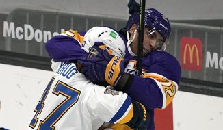 St. Louis Blues defenseman Torey Krug, left, and Los Angeles Kings left wing Andreas Athanasiou fight during the second period of an NHL hockey game Wednesday, March 17, 2021, in Los Angeles. (AP Photo/Mark J. Terrill)