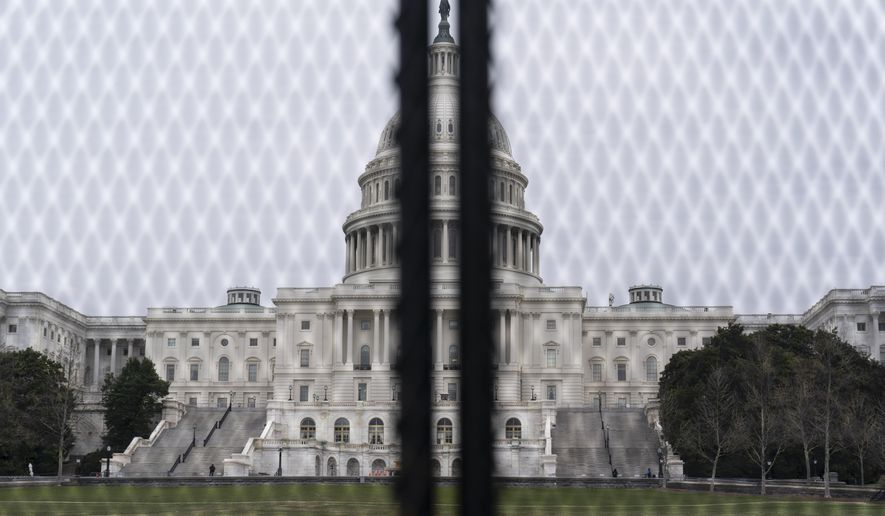 An inner perimeter anti-scaling fence is around the U.S. Capitol, Tuesday, March 16, 2021, in Washington. (AP Photo/Alex Brandon)